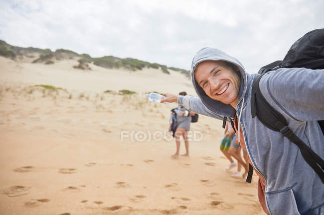 Portrait happy, carefree man on beach — Stock Photo