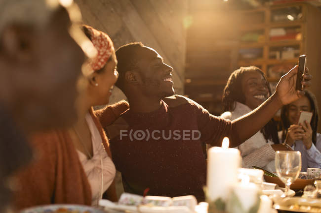 Happy mother and son taking selfie at Christmas dinner — Stock Photo