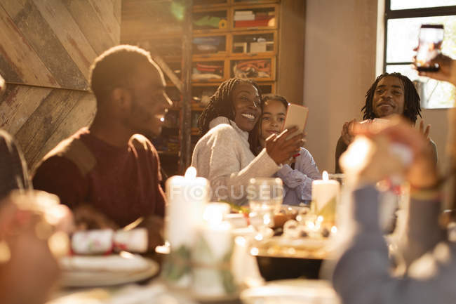 Mother and daughter taking selfie at Christmas dinner table — Stock Photo