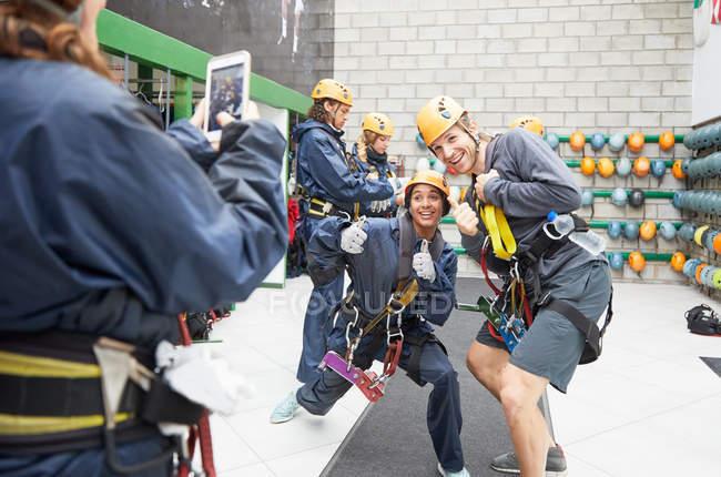 Playful friends in zip line equipment posing — Stock Photo