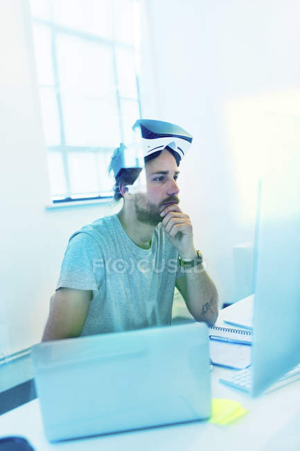 Focused computer programmer programming virtual reality simulator glasses — Stock Photo