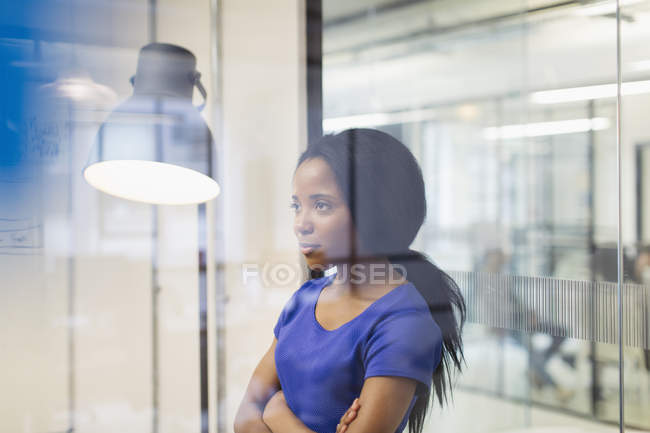 Focused, determined businesswoman in office — Stock Photo