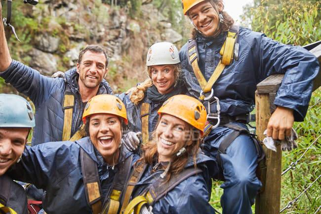 Portrait smiling, confident friends zip lining — Stock Photo