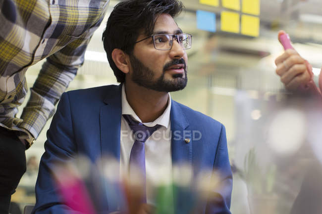 Focused, attentive businessman listening in meeting — Stock Photo