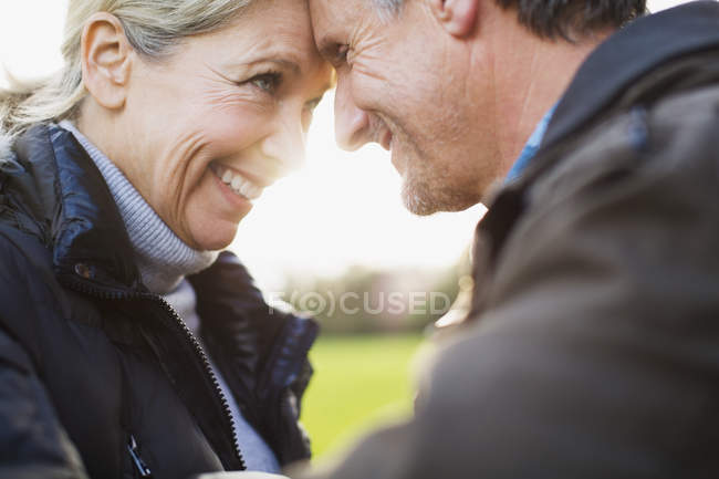 Mature caucasian couple looking at each other — Stock Photo