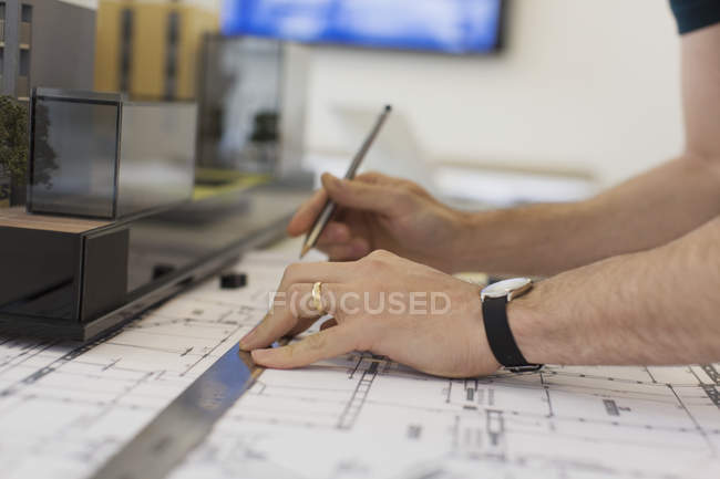 Close up architect drafting blueprint with ruler and pencil — Stock Photo
