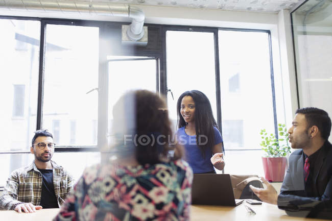 Creative businesswoman leading conference room meeting — Stock Photo