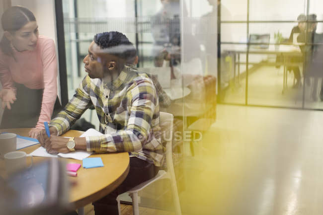 Creative business people talking, brainstorming in conference room meeting — Stock Photo