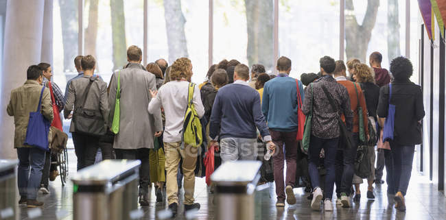 Business people leaving office lobby — Stock Photo