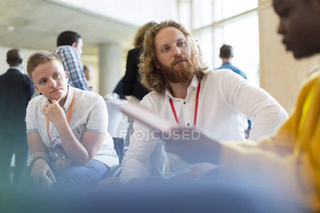 Attentive business people talking at conference — Stock Photo
