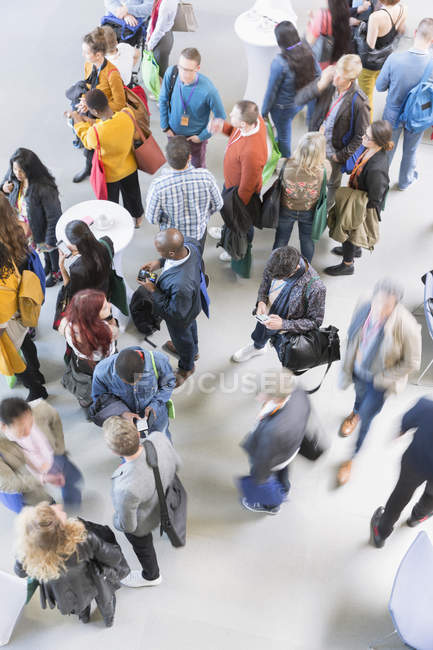 Business people networking, talking at conference — Stock Photo