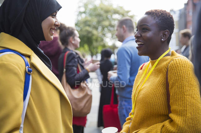 Businesswomen talking at conference at modern office — Stock Photo