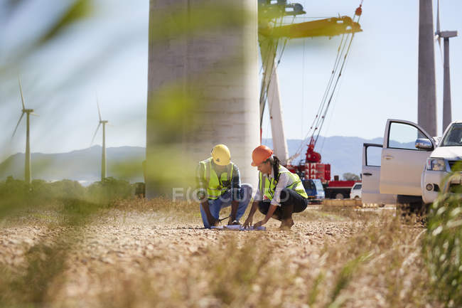 Engineers reviewing plans at turbine power plant — Stock Photo
