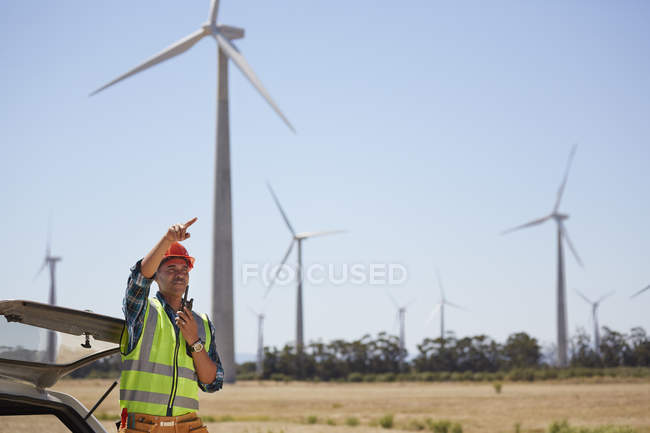 Engineer with walkie-talkie at wind turbine power plant — Stock Photo