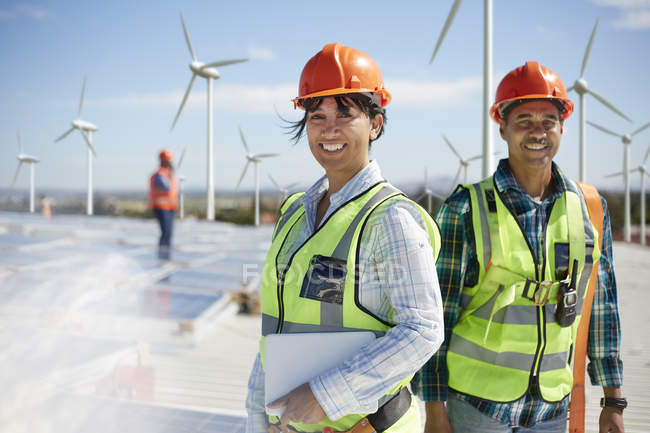 Portrait confident engineers at alternative energy power plant — Stock Photo