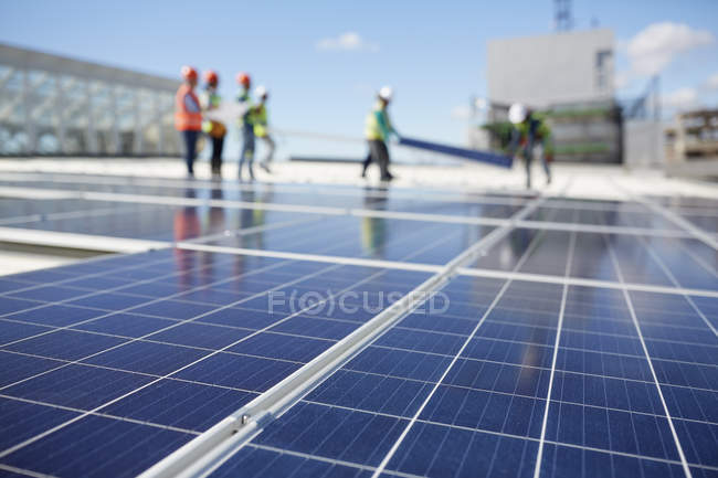 Solar panels at sunny power plant — Stock Photo