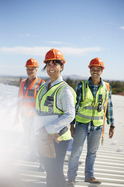 Portrait smiling, confident engineers at sunny power plant — Stock Photo