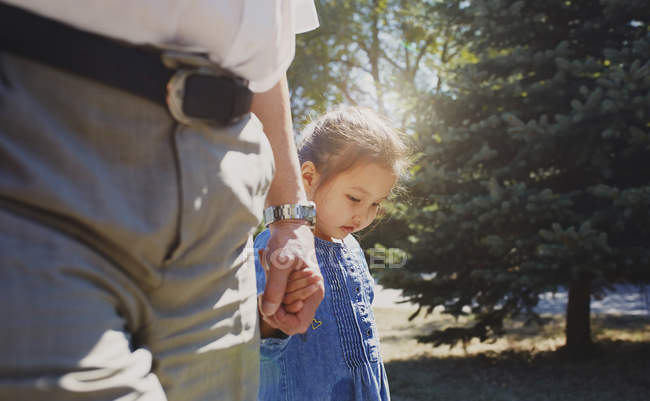 Grandfather holding hands with innocent granddaughter — Stock Photo