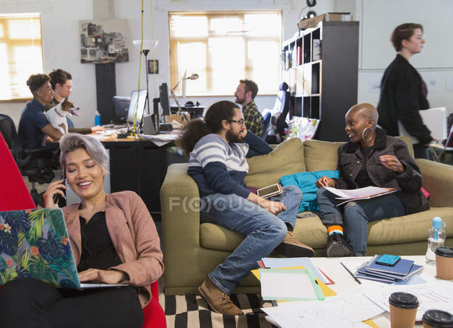Creative business people meeting and working in casual, open plan office — Stock Photo