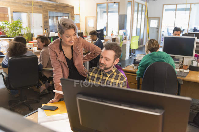 Creative business people meeting in open plan office — Stock Photo
