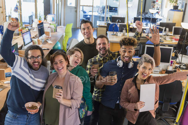 Portrait enthusiastic creative business team cheering — Stock Photo
