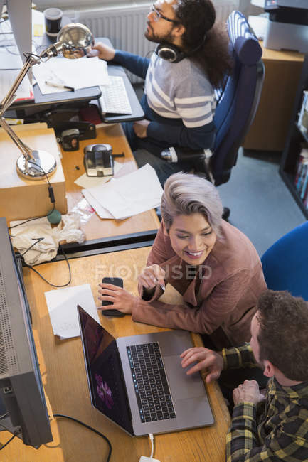 Creative business people meeting, working at laptop in office — Stock Photo