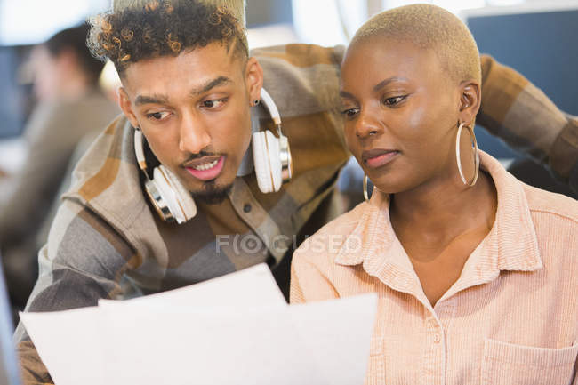 Focused creative business people reviewing paperwork — Stock Photo
