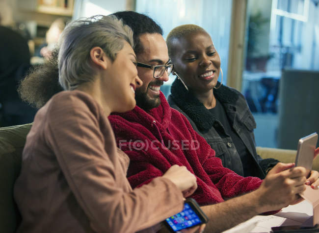Creative business people using digital tablet — Stock Photo