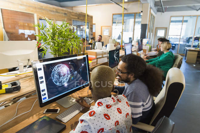 Graphic designers working in open plan office — Stock Photo