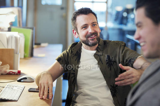 Creative businessmen talking, meeting in office — Stock Photo