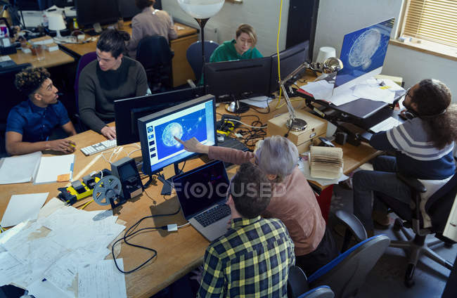 Creative designers working, meeting n open plan office — Stock Photo