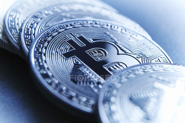 Close up Bitcoins on silver surface — Stock Photo