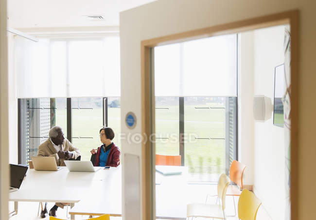 Senior business people meeting in conference room — Stock Photo