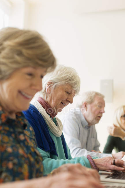 Smiling senior business people in conference room meeting — Stock Photo