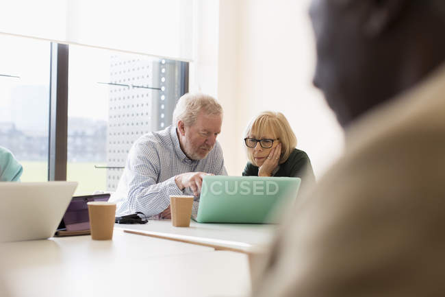 Senior business people using laptop in conference room meeting — Stock Photo