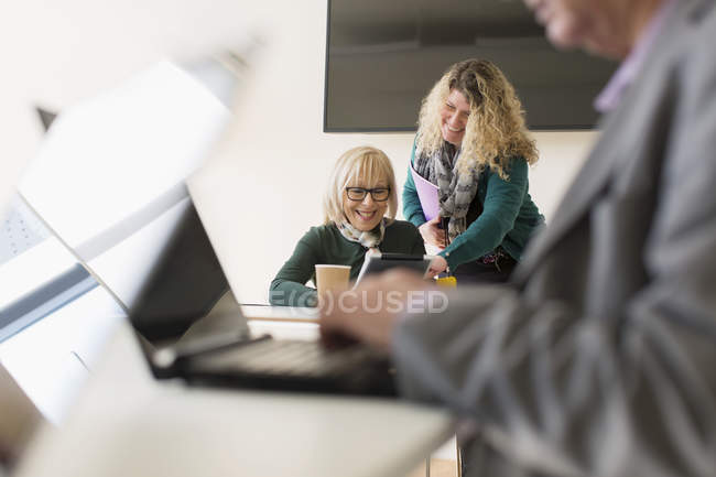 Businesswomen using digital tablet in conference room meeting — Stock Photo