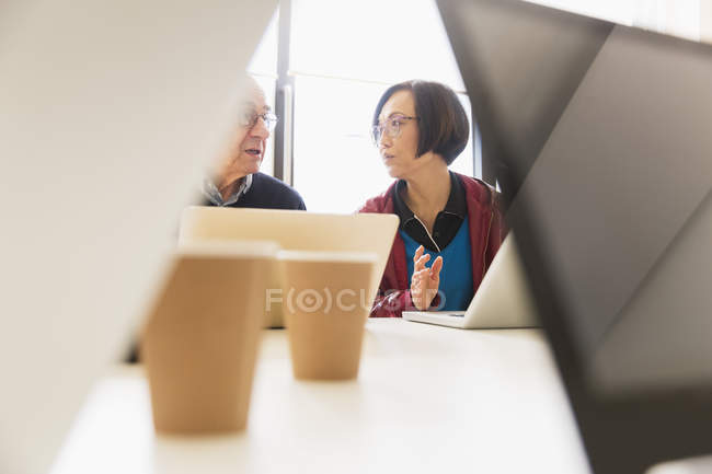 Business people talking, using laptops in conference room meeting — Stock Photo