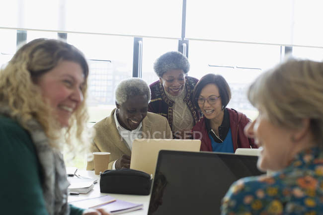 Senior business people working at laptop in conference room meeting — Stock Photo