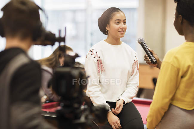 Teenagers with microphone and video camera vlogging — Stock Photo