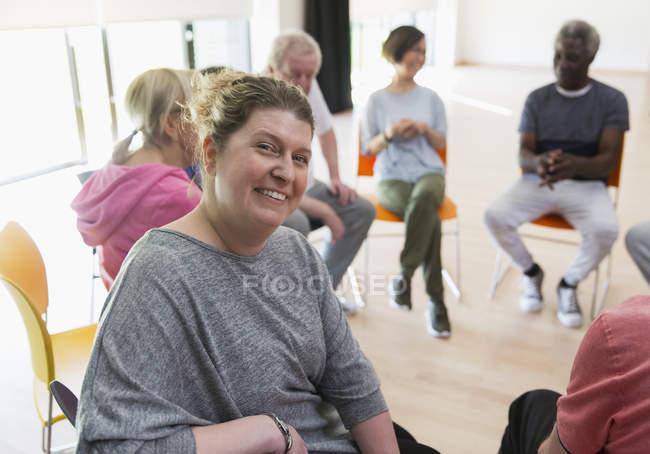 Portrait smiling instructor leading active senior exercise class — Stock Photo