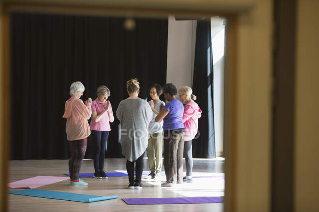 Serene active seniors practicing yoga in circle — Stock Photo