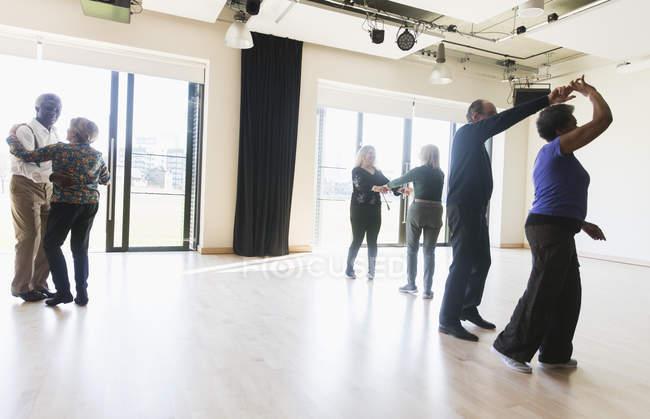 Active seniors dancing in dance class — Stock Photo
