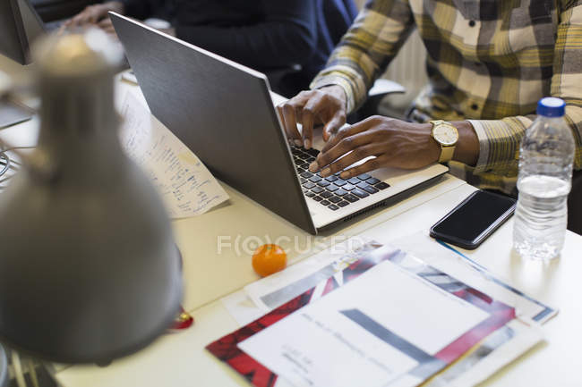 Businessman working at laptop in office — Stock Photo