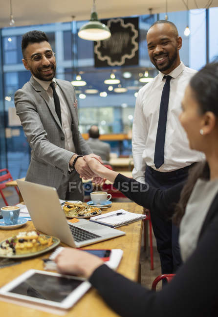 Business people handshaking, working in cafe — Stock Photo