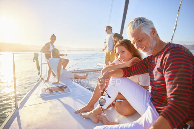 Friends relaxing on sunny catamaran — Stock Photo