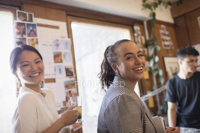 Portrait laughing creative businesswomen in office — Stock Photo