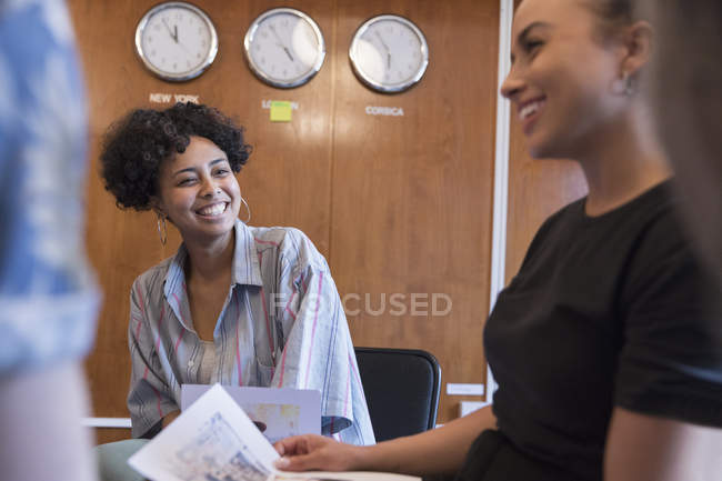 Creative businesswomen laughing in meeting — Stock Photo
