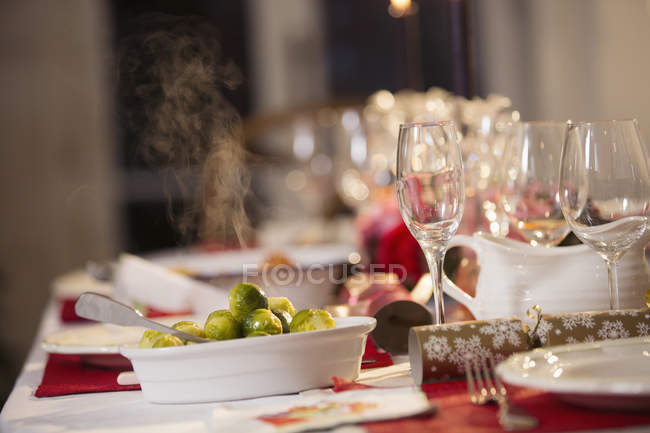 Steaming Brussels sprouts on Christmas dinner table — Stock Photo