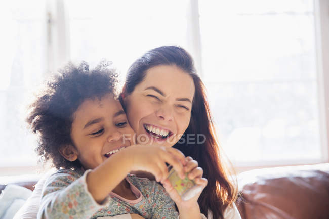 Laughing, carefree mother and daughter — Stock Photo
