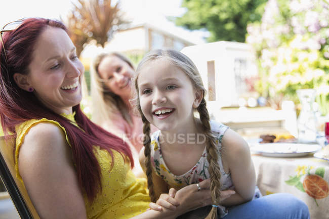 Affectionate mother and daughter on patio — Stock Photo